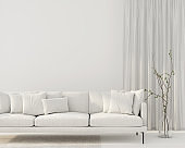 Interior of the living room with a white sofa