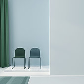 Blue and green interior composition with two chairs