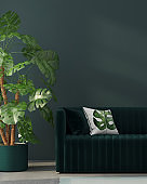 Interior with green sofa and tropical plant