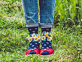 Women's legs, fashionable shoes and bright socks