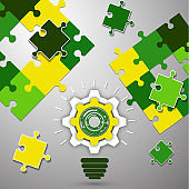Puzzles, light bulb, gear. The idea of solving the puzzle. The concept of teamwork, cooperation and partnership. Flat design.