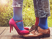 Men's and women's legs, bright socks. Close-up