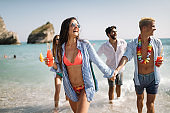 Group of happy people having fun at summer. Beach vacation friends travel concept