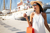 Beautiful woman with shopping bag. Sale, shopping, tourism and happy people concept