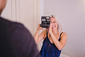 Couple taking pictures at home. Capture and learning photography concept.