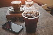 Ice americano coffee in plastic glass.
