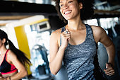 Close up image of attractive woman in gym