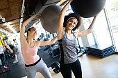 Beautiful sexy woman training pilates in gym