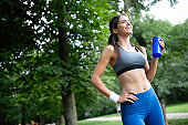 Healthy lifestyle image of young woman exercising outside