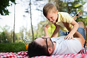 Father and his son playing and hugging outdoor