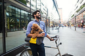 Handsome young businessman walking with his lovely dog.