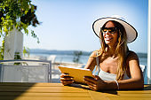 Beautiful woman selecting summer sea destination for holiday vacation