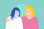 Concept of friendship and support. Two women are together. Cheerful woman supports sad woman
