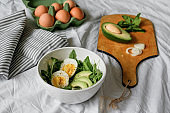 tasty and healthy breakfast. Greens with avocado and eggs. beautiful table setting.