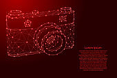 Photo camera from futuristic polygonal red lines and glowing stars for banner, poster, greeting card. Vector illustration.