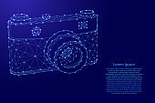 Photo camera from futuristic polygonal blue lines and glowing stars for banner, poster, greeting card. Vector illustration.