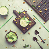 Pistachio cocktail with milk and mint, gray kitchen table, copy space, top view