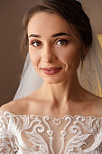 Wedding portrait. Bride with beautiful make-up and hearstyle in white wedding dress
