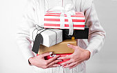 women hand holding gift box and paper tag isolated on white background for christmas and new year concept.