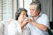 Asian Senior husband taking care his wife.
