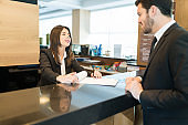 Receptionist Assisting Professional With Document