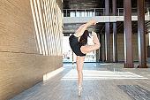 Skilled ballet dancer performing on street