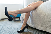 Female Executive Wearing Stilettos In Hotel Room