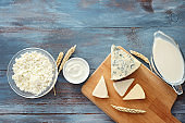 Tasty dairy products on color wooden table