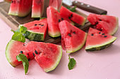 Slices of ripe watermelon on color table