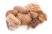 Variety of fresh tasty bread on white background