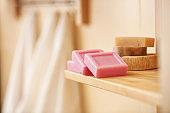Soap bars on shelf in bathroom