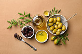 Composition with olive oil on color background