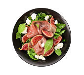 Plate with delicious fig salad on white background