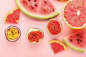 Summer composition with ripe fruits on color background