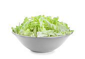 Bowl with shredded cabbage on white background