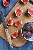 Fresh ripe figs on wooden board
