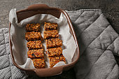 Baking tray with tasty granola bars on table