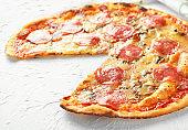 Tasty pepperoni pizza on table