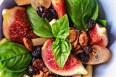 Bowl with delicious fig salad, closeup