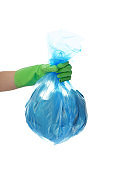Woman holding garbage bag on white background