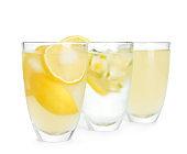 Glasses with cool fresh lemonade on white background