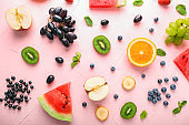 Composition with various fruits on color background