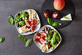Plates with delicious fig salad on grey table