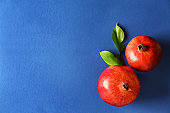 Juicy pomegranates on color background