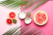 Flat lay composition with various delicious fruits on color background