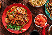 Assortment of Chinese food on wooden table