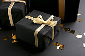 Beautiful Christmas gifts on black background