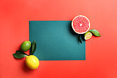 Composition with various delicious fruits and blank card on color background