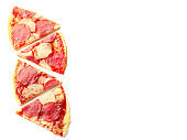 Pieces of pepperoni pizza on white background