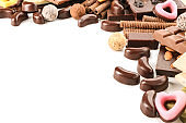 Delicious chocolate with candies on  white background
